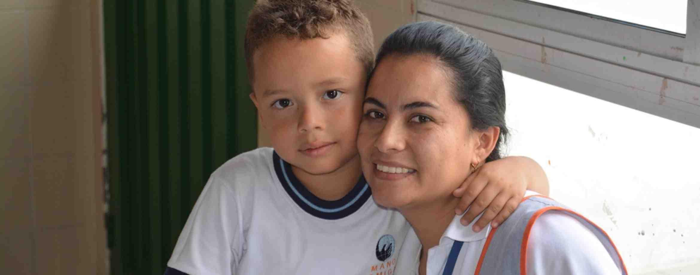 Mano Amiga Teacher With Student