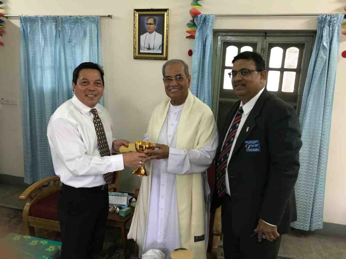 Bangladesh - Deacon Rick Medina, CWM Executive Director, and Danny Sequeira, CWM partner, present Cardinal D'Rozario of Bangladesh with a new chalice and paten.