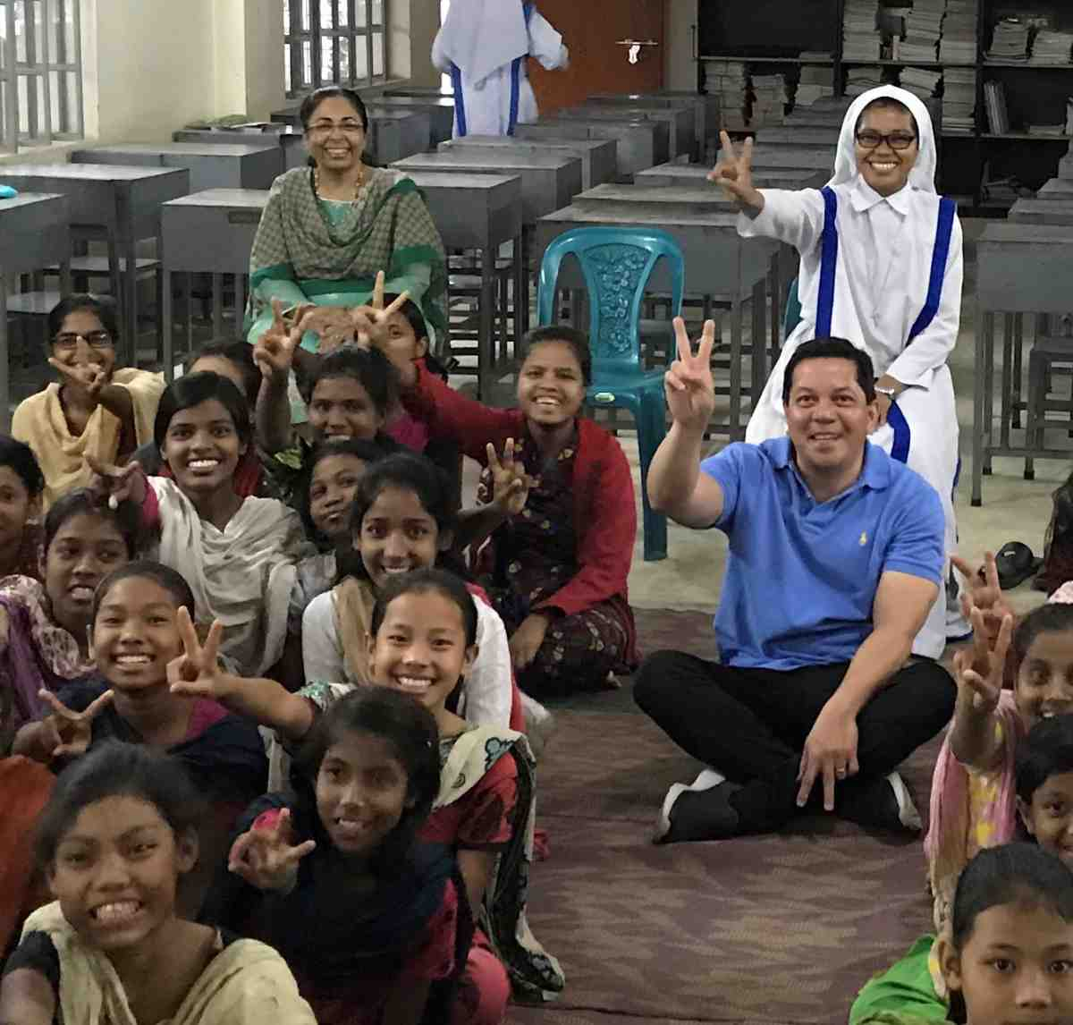 Bangladesh - Deacon Rick Medina, CWM Executive Director, pictured with Sister Hima, SMRA, and residents of Bottomley Home Girls' Orphanage
