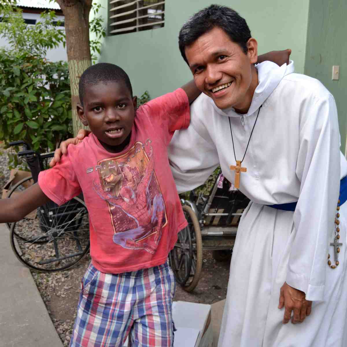 Catholic missionary spending time with resident of care home