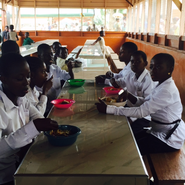 Children in new covered dining hall - Ghana