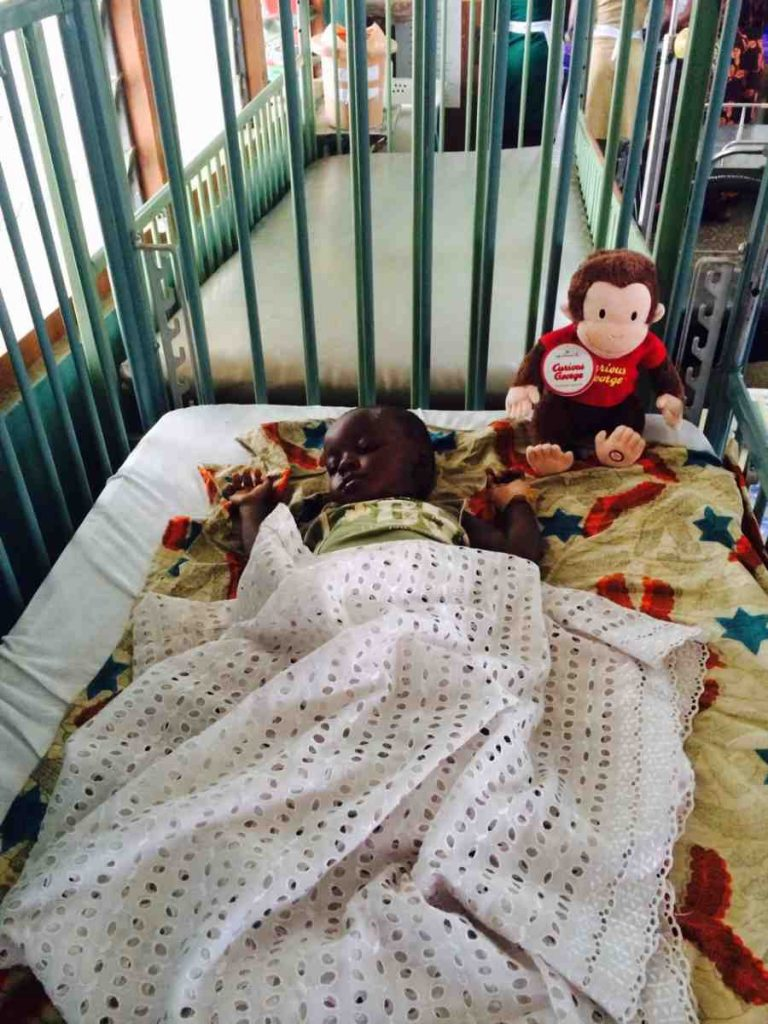 A Curious George doll for baby in Ghana Hospital