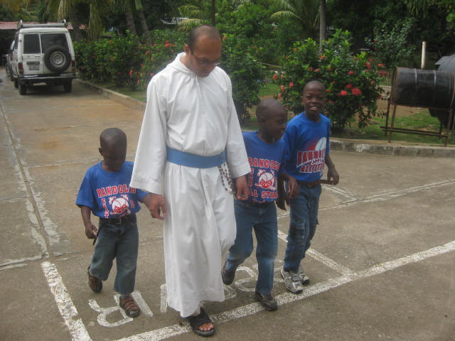 Catholic missionary helping poor Haitian children