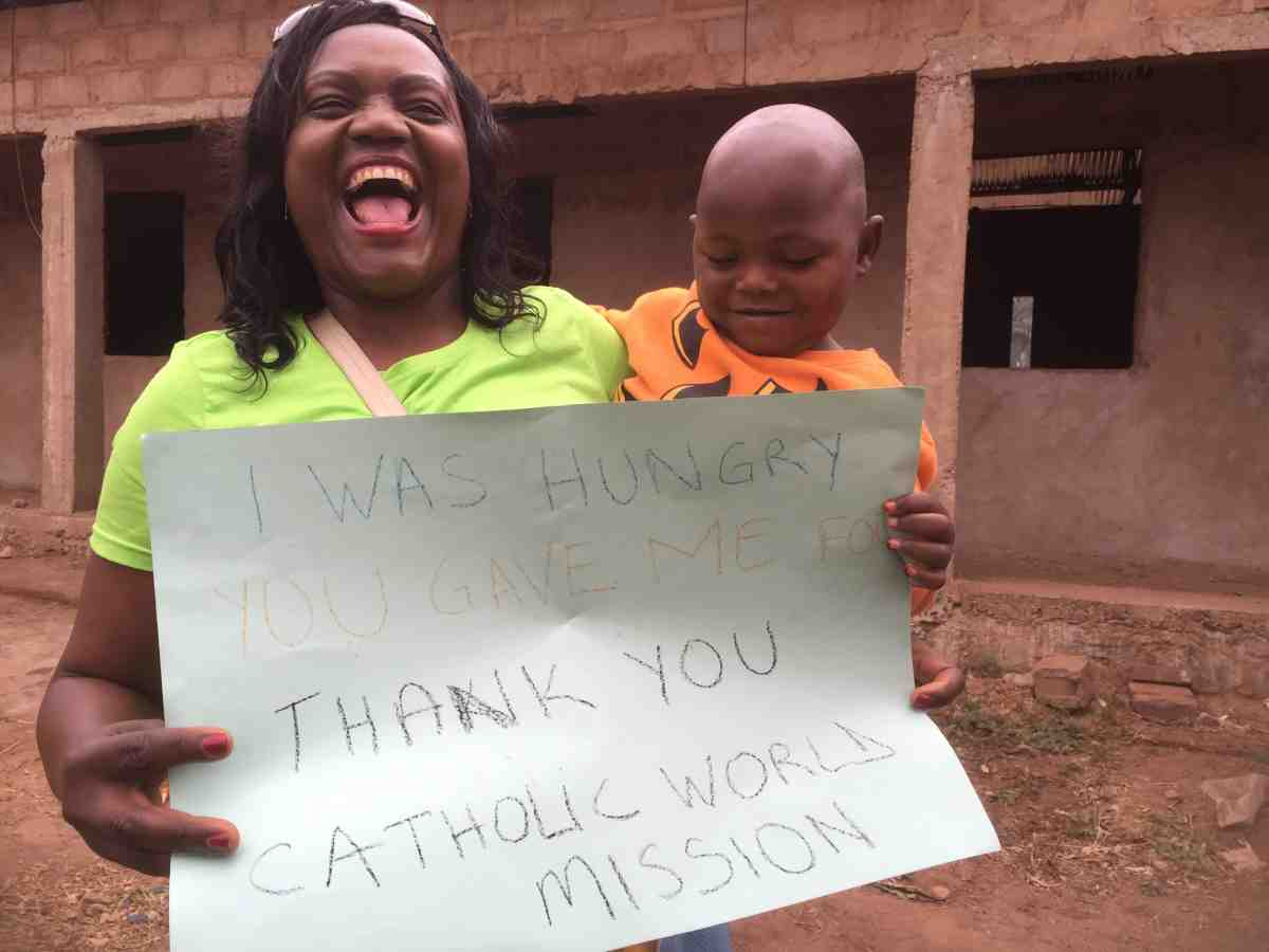 Catholic nun with orphans of DR Congo thanking Catholic World Mission