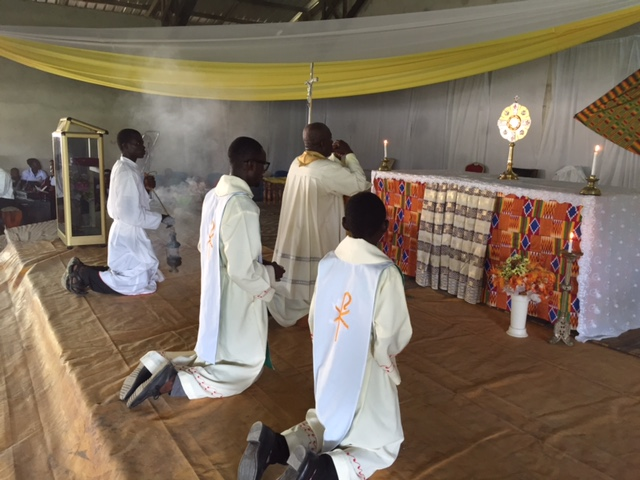 Ghana - People in prayer at Immaculate Conception Church in Enchi