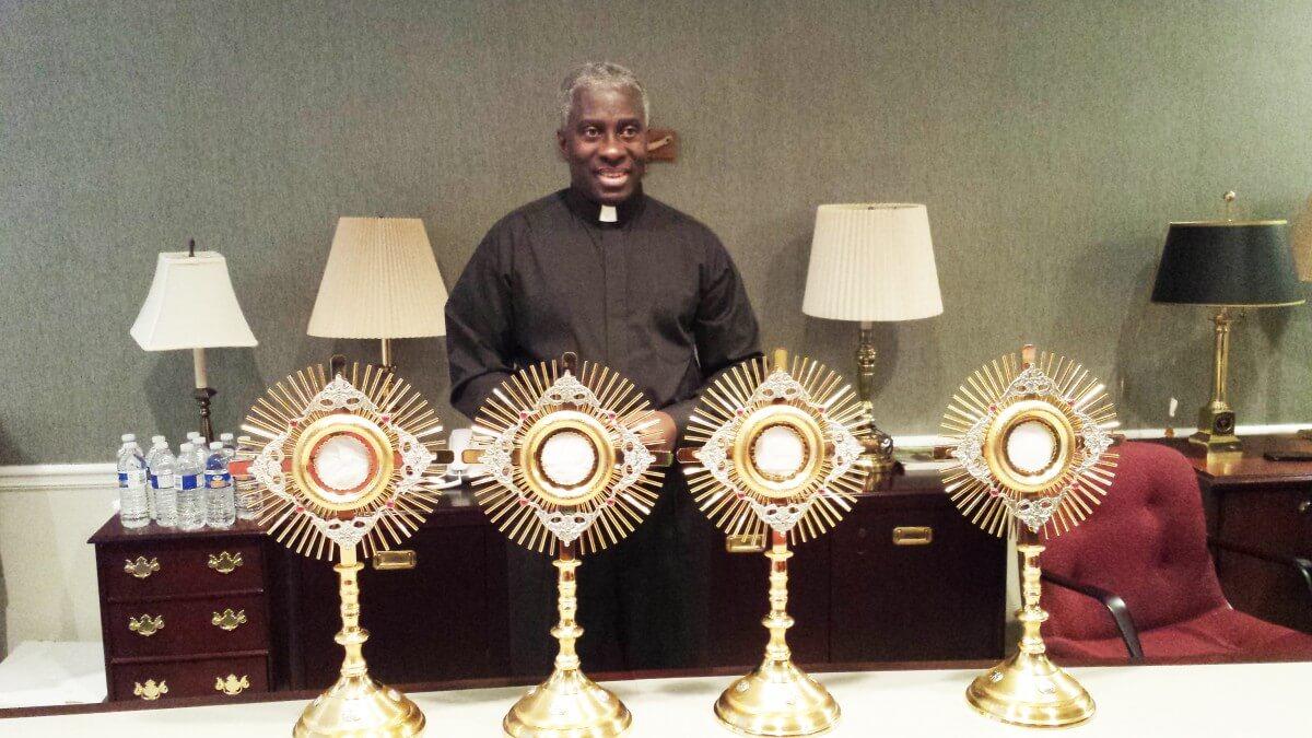 Monsignor Simon displaying monstrances