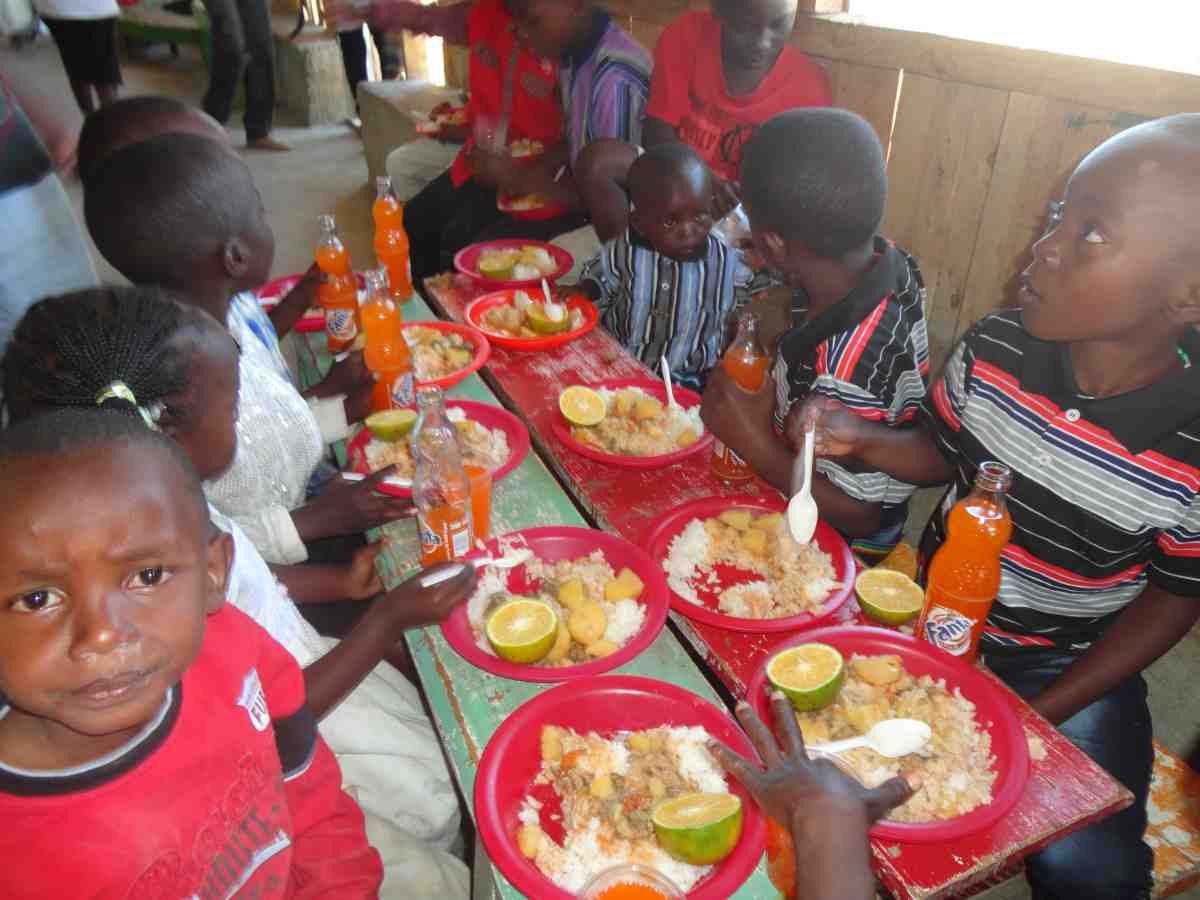 children in Kenya being fed by Catholic Missionaries