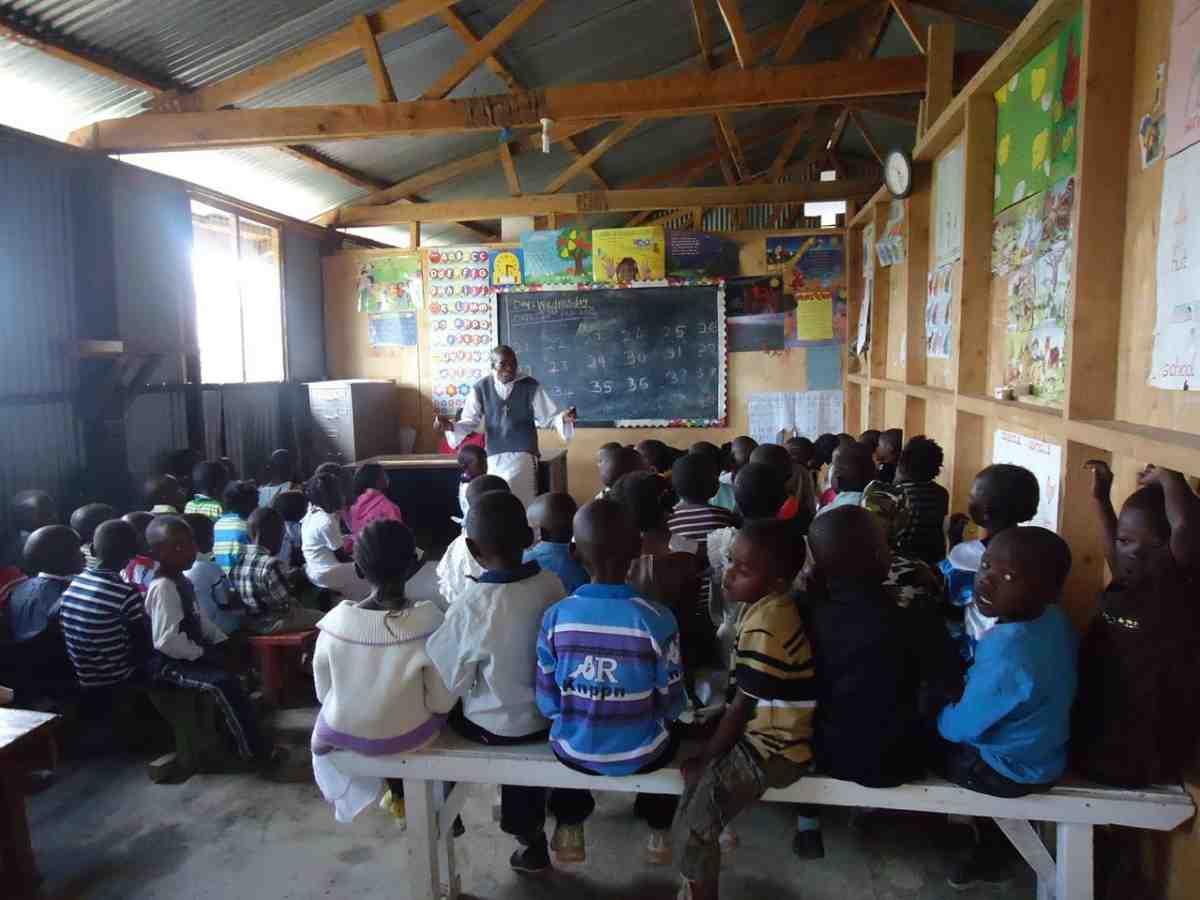 Catholic Missionary teaching children in Kenya