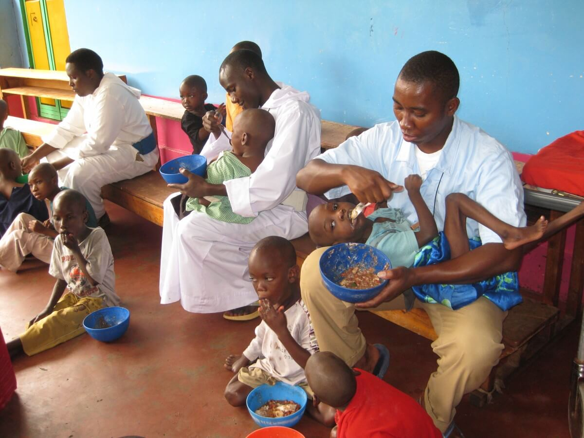 Catholic Missionaries feeding hungry children in Kenya