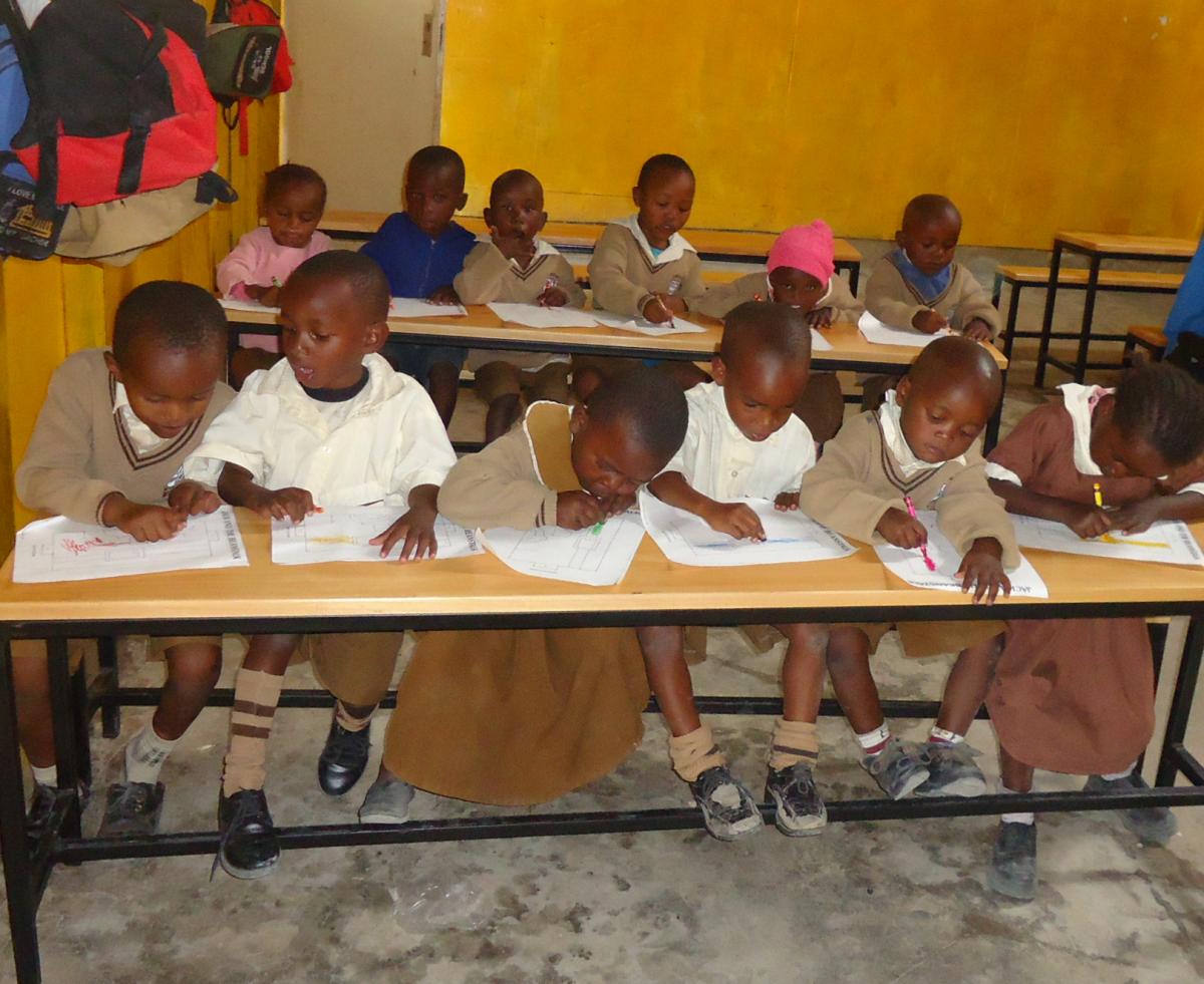 Catholic Academy Students Learning at New Desks