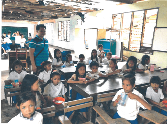 Agtatacay Notre Elementary students in class despite the crumbing classroom - Philippines