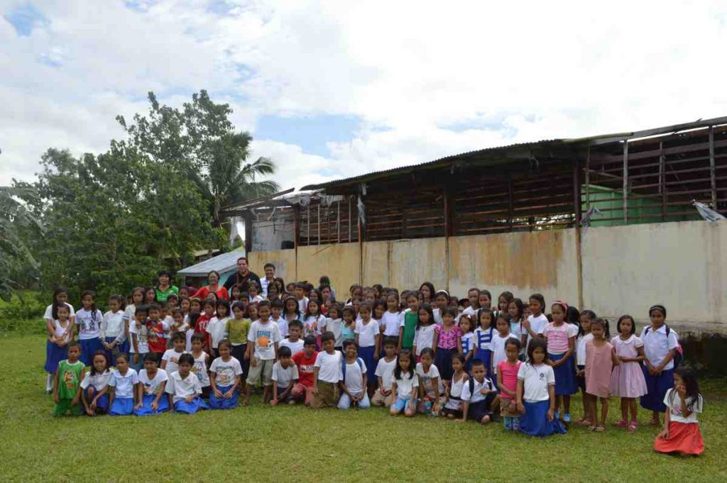 Deacon Rick Medina with the children from Agtatacay Notre Elementary - Philippines