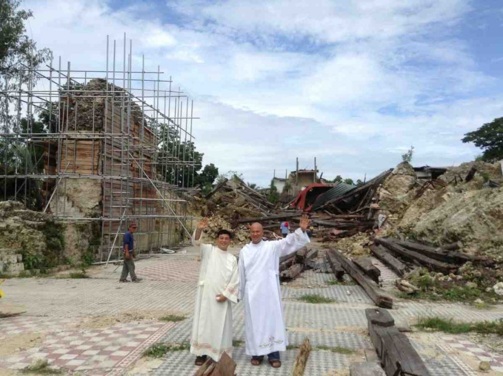 Fr. Saco & Fr. Relampagos standing in the ruins of church built in the 1800s - Philippines