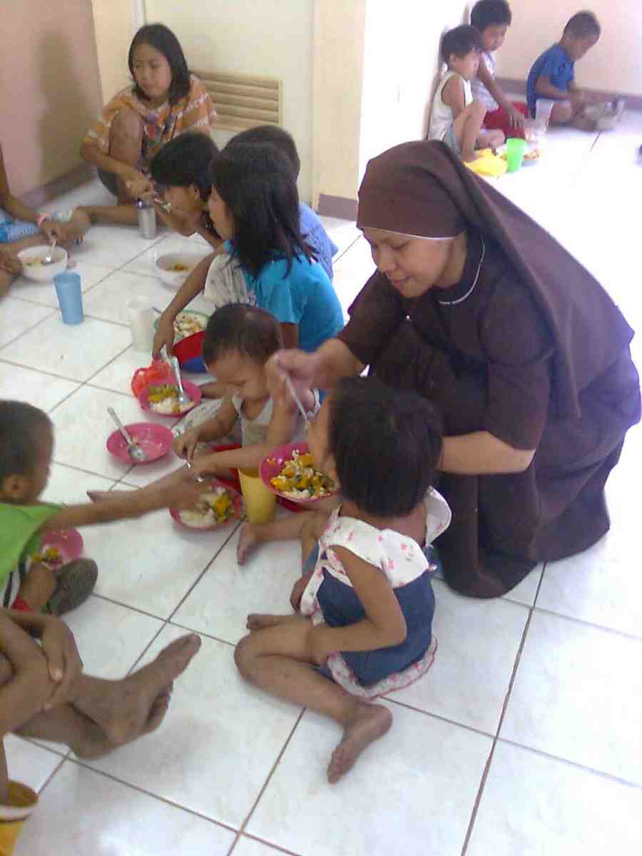 The Compassionate Sisters feeding the children - Philippines