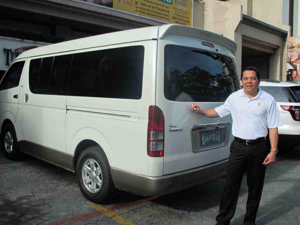 Deacon Rick next to the new van - Philippines