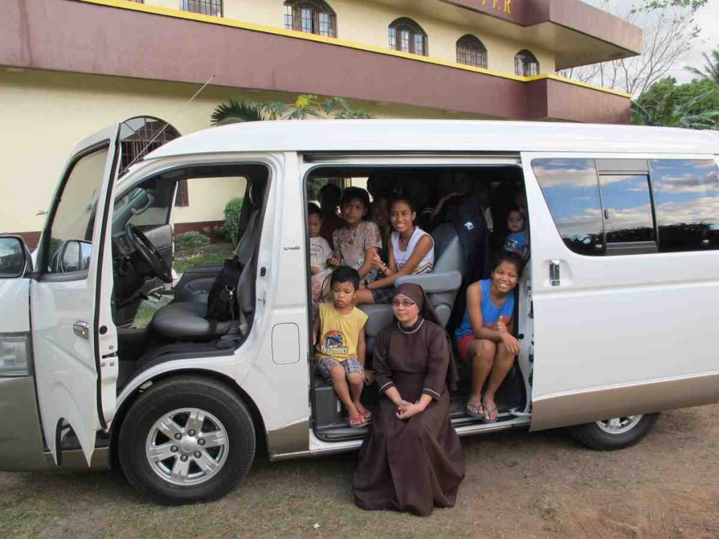 Children happy about the new van - Philippines