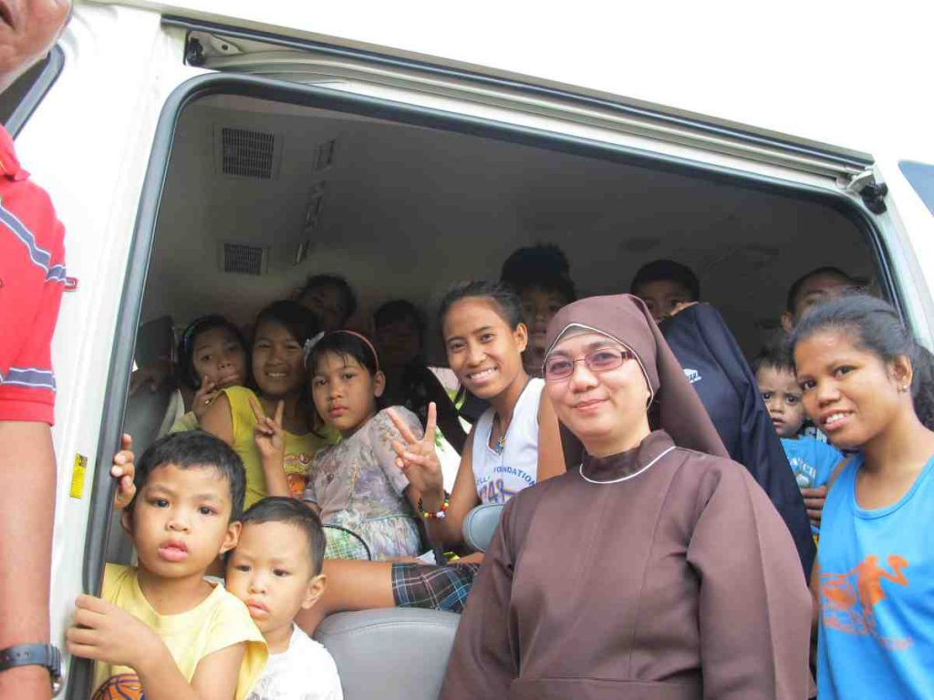 The Compassionate Sisters with their orphans and new van - Philippines