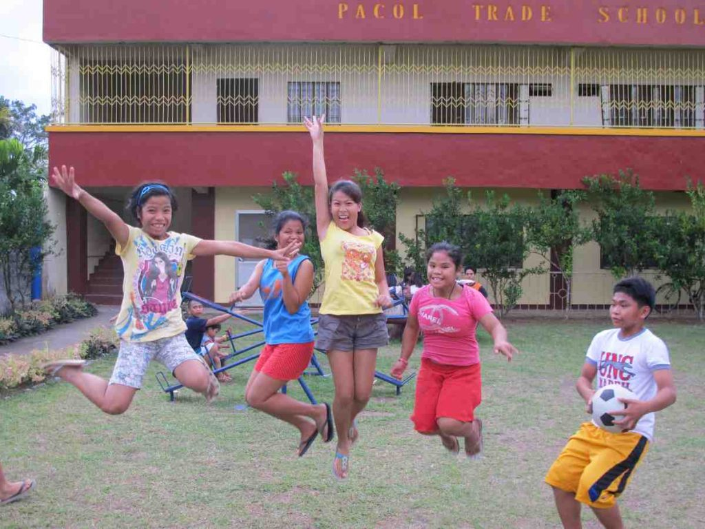 Queen of Peace orphans jumping for joy - Philippines