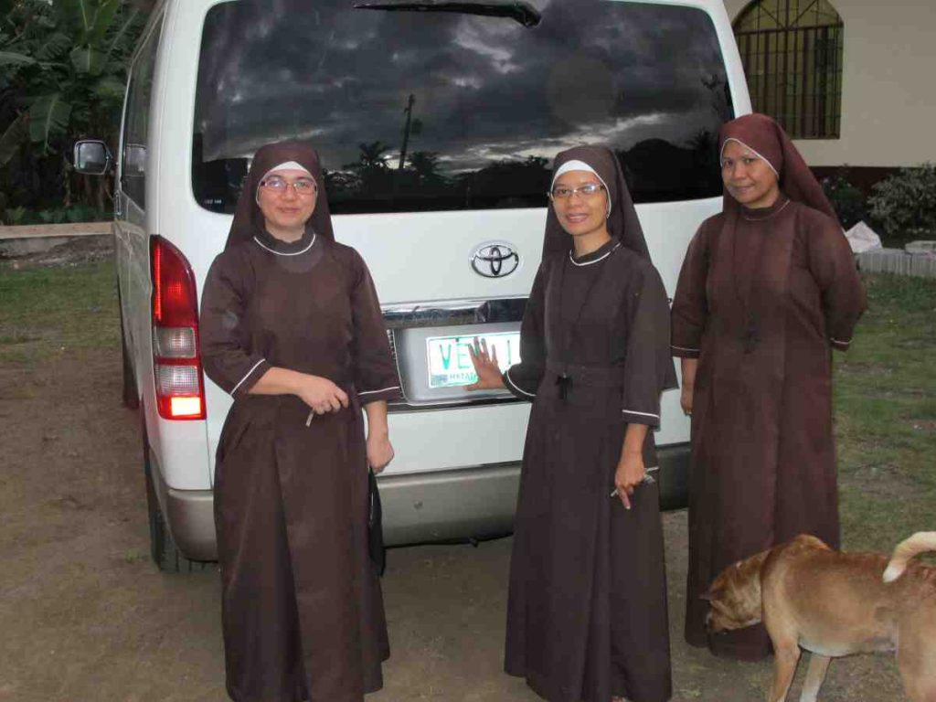 The sisters with their new van - Philippines