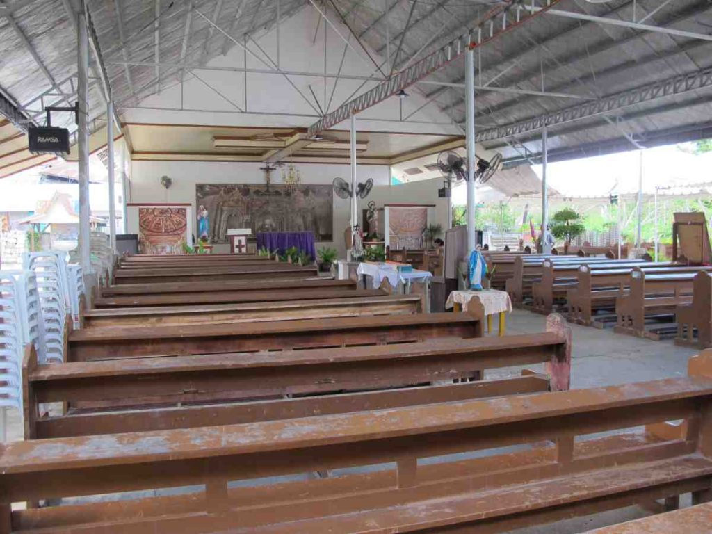Temporary Maribojoc church with salvaged pews - Philippines