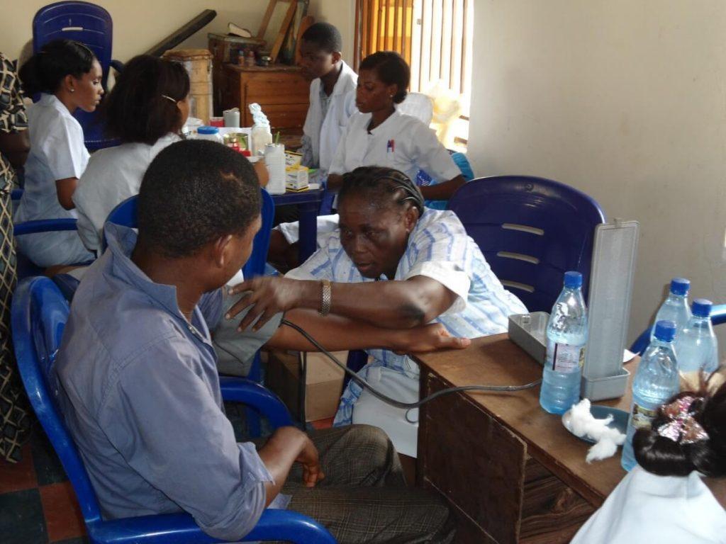 Nurse helping patients at Nigeria Medical Mission