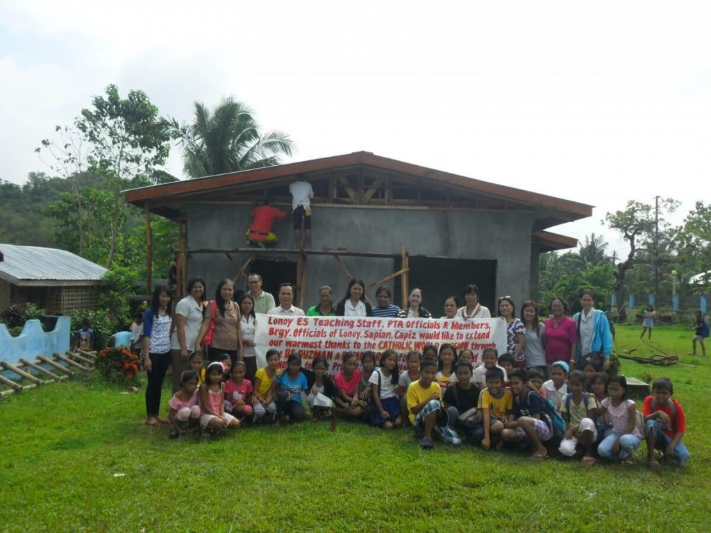 Lonoy Elementry School holds up a Thank You banner for CWM Donors - Philippines