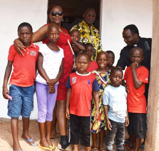 CWM partner Ide with the Ndekesha orphans, Bishop Pierre Celestin, and Fr. Donatien