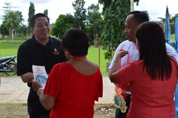 Executive Director Deacon Rick Medina greeted by Lonoy Elementary\'s principal on his arrival - Philippines