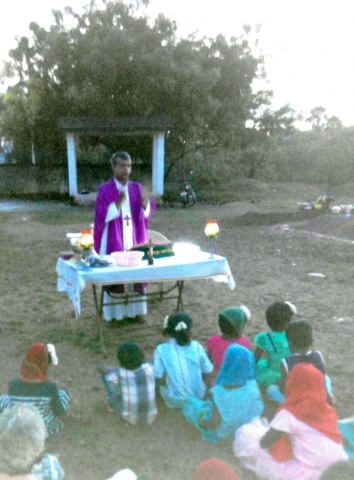 Fr. Arivu celebrates Mass outside