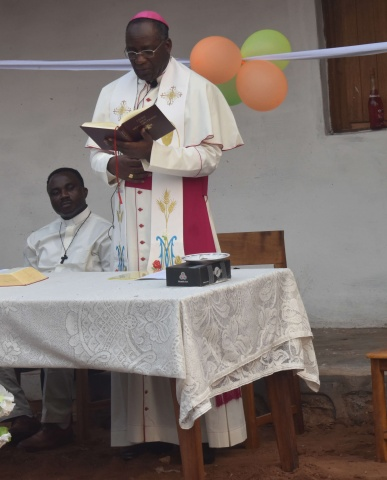 Bishop Pierre Celestin leads a prayer service/dedication at the newly renovated Ndekesha orphanage