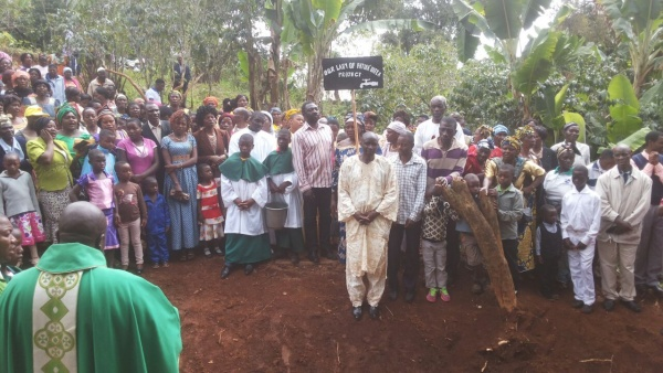 Blessing the water well with the village - Cameroon