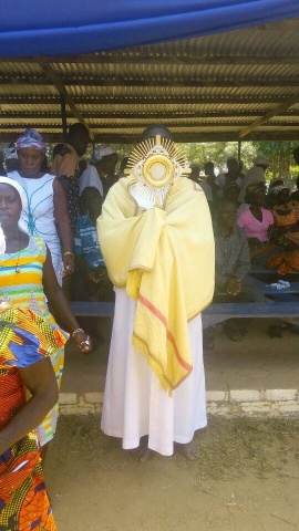 Fr. Anthony Eshun processes with the Blessed Sacrament at the Our Lady of Lourdes grotto in Ghana