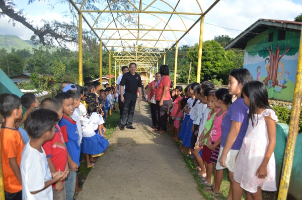 Executive Director Deacon Rick Medina among students at Lonoy Elementary - Philippines
