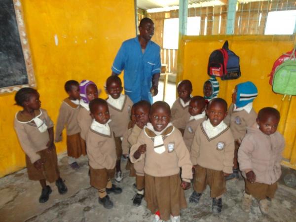 Good Shepherd Academy students with volunteer teacher - Kenya