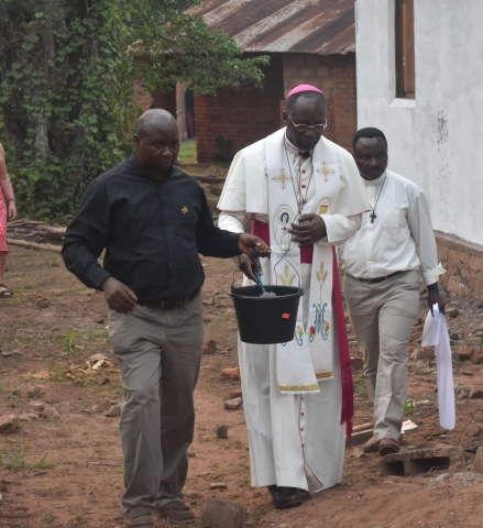 Bishop Celestin blesses the property and grounds of Ndekesha Orphanage