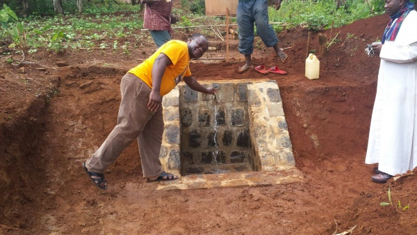 Fr. Eugen inspects the water well - Cameroon