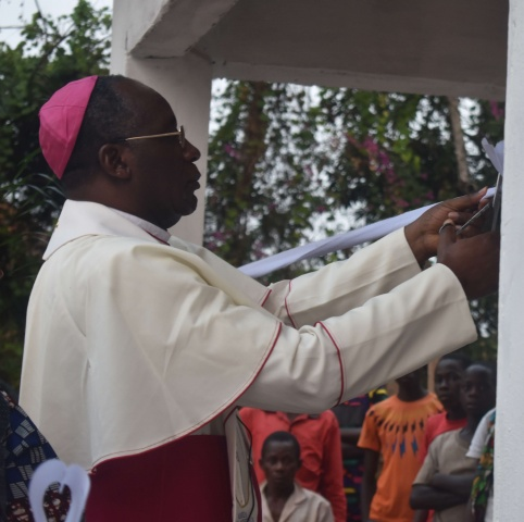 Bishop Celestin cuts the ribbon at the Ndekesha orphanage, marking its official re-opening