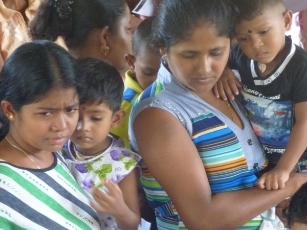 Sri Lanka Medical Mission - Young mothers wait with their young children - Giribawa