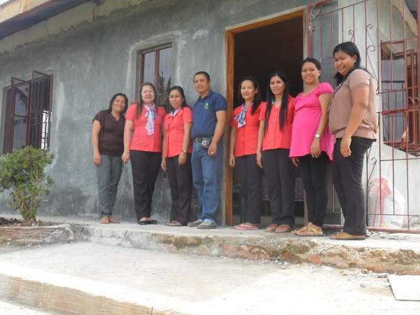 Agtatacay Notre Elementary teachers proudly standing before their new school building - Philippines