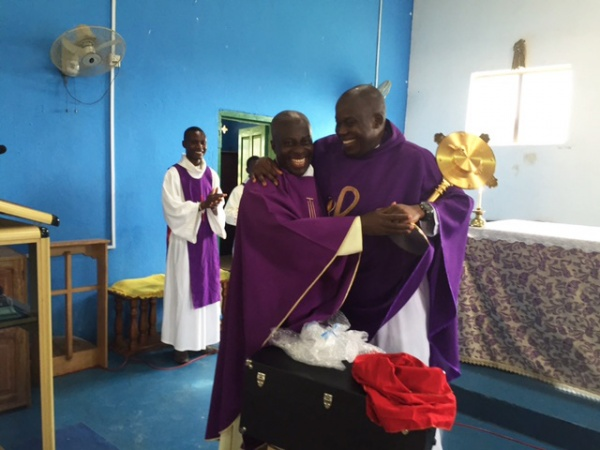 Fr. Anthony Affrul Broni receives his parish\'s new monstrance from Msgr. Simon, and he is thrilled!