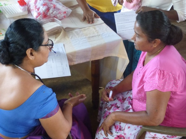 Sri Lanka Medical Mission - a local doctor counsels a patient - Giribawa