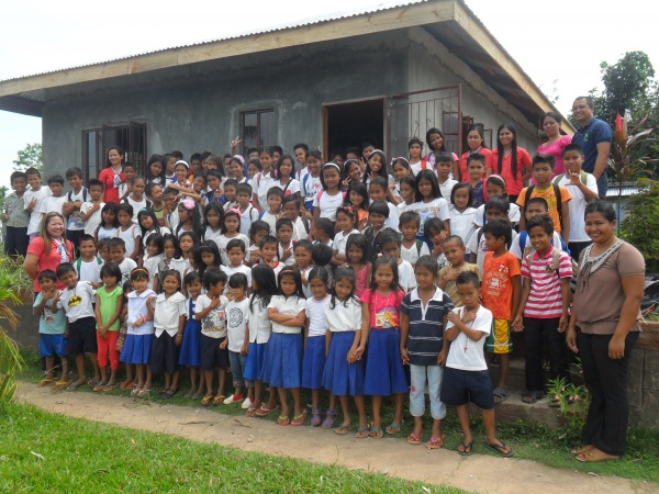 Agtatacay Notre Elementary students proudly standing before their new school building - Philippines