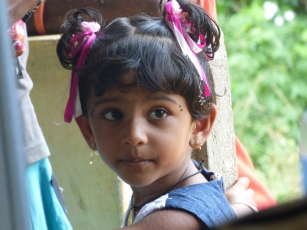 Sri Lanka Medical Mission - this cute little girl waits for a doctor - Giribawa