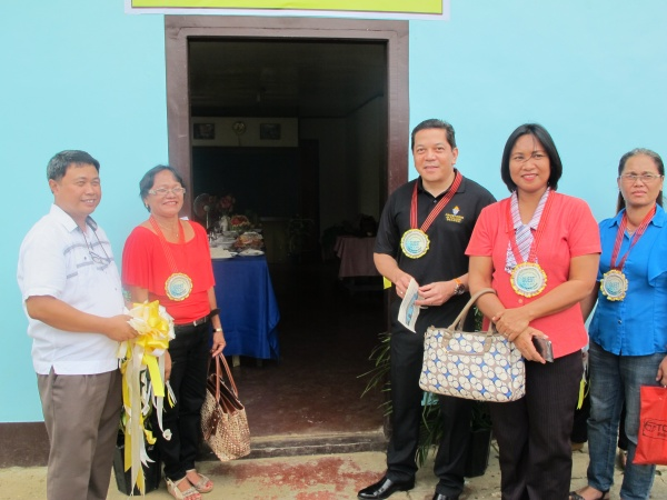 Executive Director Deacon Rick Medina outside the new Home Economics building at Lonoy Elementary - Philippines