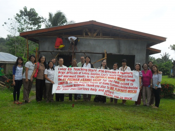 Lonoy Elementary teachers displaying their thanks to CWM - Philippines