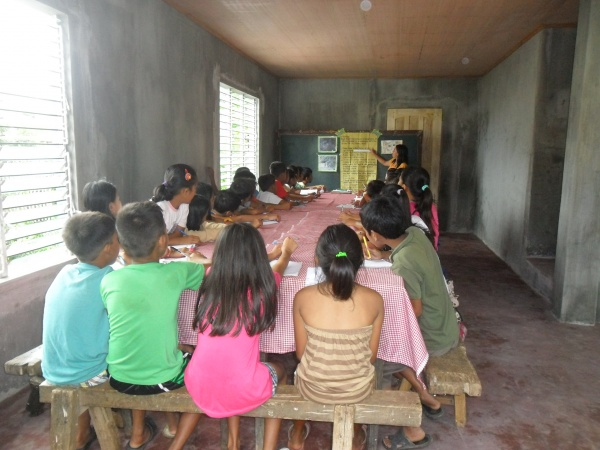 Children learning in their new Home Economics building - Philippines