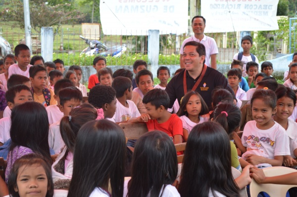 Executive Director Deacon Rick Medina with students from Lonoy Elementary - Philippines
