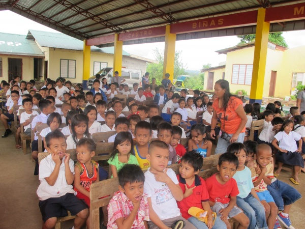 The children await the Turning Over the Keys ceremony at Agtatacay Notre Elementary - Philippines
