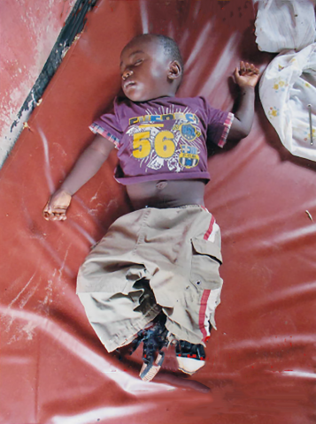 Emery asleep at Ndekesha Orphanage