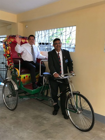 Bangladesh - Deacon Rick and Danny Sequeira try out a rickshaw